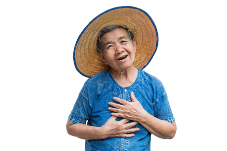 Anxiety old Asian woman farmer on a white background Reklamní fotografie