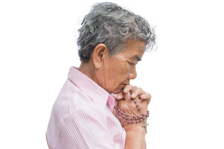 Old woman praying on white background, Concept hope and worship