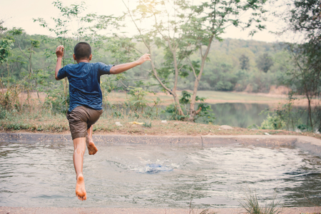 Happy moment Asian boy playing water in outdoor , relax time and summer season Reklamní fotografie