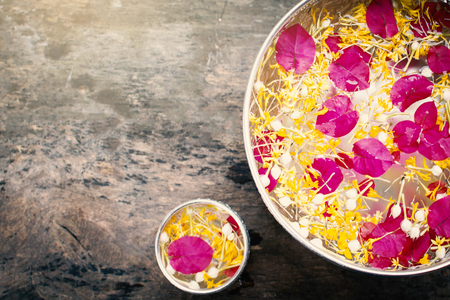 Water and fresh flower in a bowl  on old wood background, Songkran  festival in Thailand Reklamní fotografie