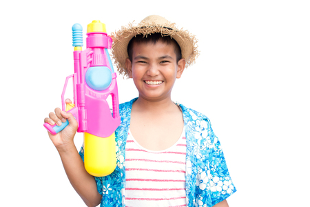Cute boy playing water gun on white background, Songkran Festival in Thailand and summer season
