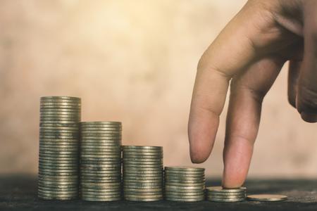 Female hand walking on money ,Financial growth concept. 版權商用圖片
