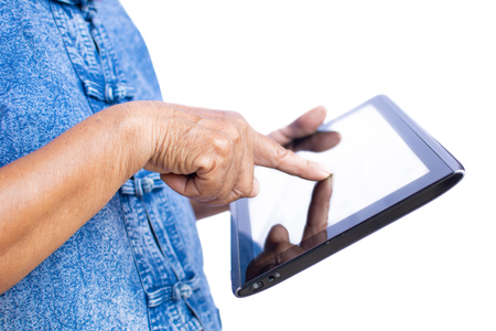 Hand of old women farmer using tablet and joyful on a white background