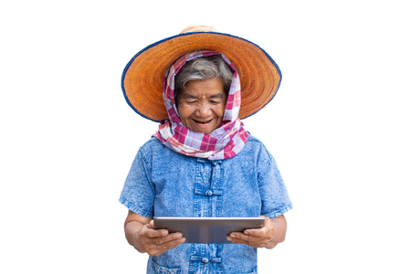 Happy old women farmer using tablet and joyful on a white background