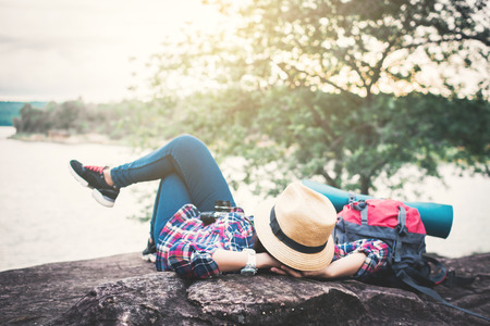 Happy Asian woman relaxing on holiday  travel concept,selective and soft focus,tone of hipster style