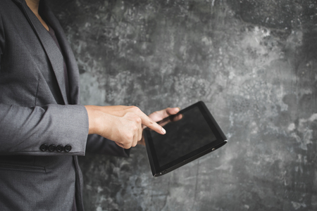 Businessman using tablet searching information