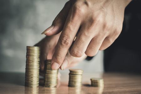 Hand set money on wood, Concept save money Reklamní fotografie