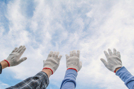 Human hand on glove teamwork concept