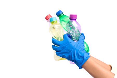 Hands holding  empty plastic bottle garbage on white background recycling concept Reklamní fotografie