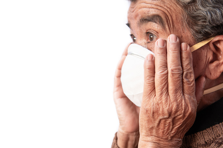Old woman wearing a mask fear problem air pollution on a white background, healthcare concept.