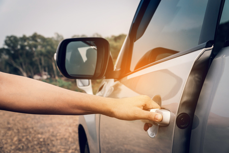 Females hand open the door car to traveling. Stock Photo