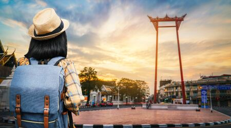 Asian woman backpacking traveling in city, journey on holiday concept .
