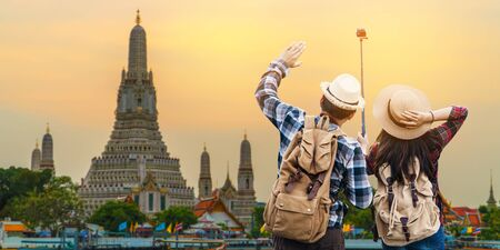 A couple backpacker traveling in landmark of Thailand, journey  on holiday concept.