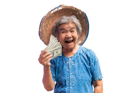 Happy old farmer woman holding a money on a white background.