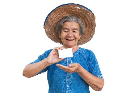 Happy old farmer woman holding a smart card on a white background. Banco de Imagens