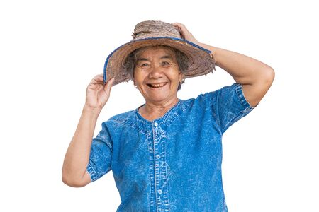 Happy old farmer woman on a white background. Banco de Imagens