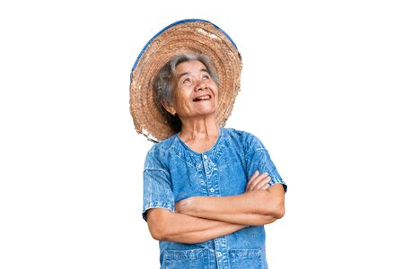 Happy old farmer woman on a white background. 版權商用圖片