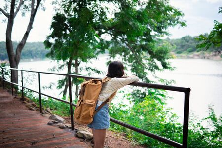 Asian girl backpack on the park background, journey and traveling on holiday concept. Stok Fotoğraf