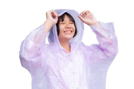 Cute Asian girl in raincoat on the white background. The rainy season concept.