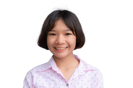 Cute Asian girl smiling on the white background.