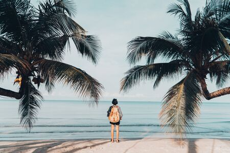 Cute girl backpack and travel on the beach. Stok Fotoğraf
