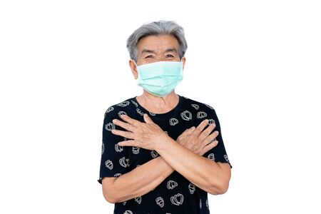 Old woman wearing a mask fear problem covid 19 and air pollution on a white background,stay at home ,healthcare concept,new normal. Zdjęcie Seryjne