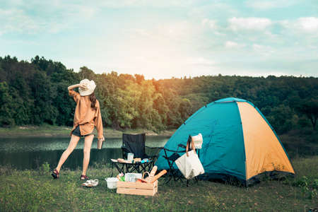 Hipster woman resting and relaxing with her camping set on the holiday and slow life. Stok Fotoğraf