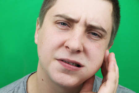 A man after removing a wisdom tooth. The operation to remove the eighth teeth