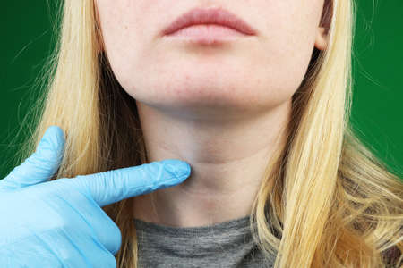 The girl on examination at the doctor. Thyroid