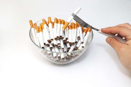 A lot of cigarettes in the plate. The concept of addiction from addiction - smoking