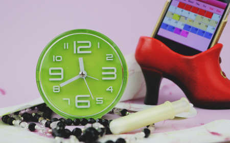 Menstrual pads, blood period calendar and clocks. Menstruation period pain protection. Feminine hygiene products