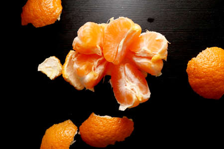 Brushed tangerine on a black background. Useful citrus Banco de Imagens - 120440842