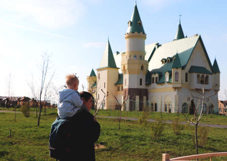 Father and son against the backdrop of the castle. The concept of travel