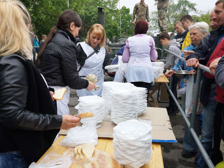 NIKOPOL, UKRAINE - MAY, 2019: distribution of food to the needy, charity event Banco de Imagens - 124659649