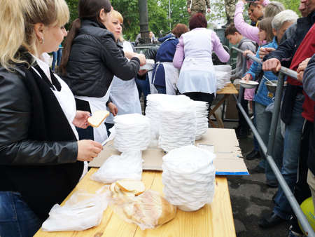 NIKOPOL, UKRAINE - MAY, 2019: distribution of food to the needy, charity event 報道画像