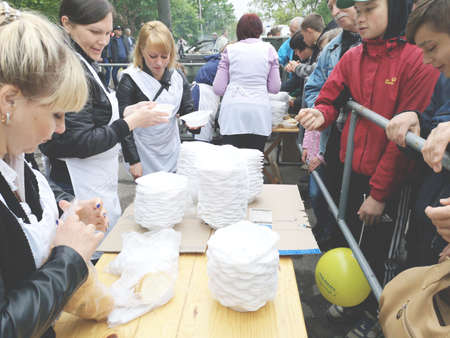 NIKOPOL, UKRAINE - MAY, 2019: distribution of food to the needy, charity event Banco de Imagens - 124659653