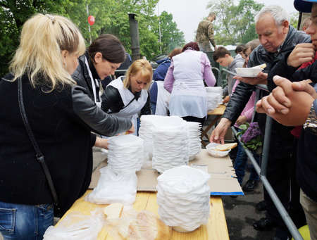NIKOPOL, UKRAINE - MAY, 2019: distribution of food to the needy, charity event Banco de Imagens - 124659656