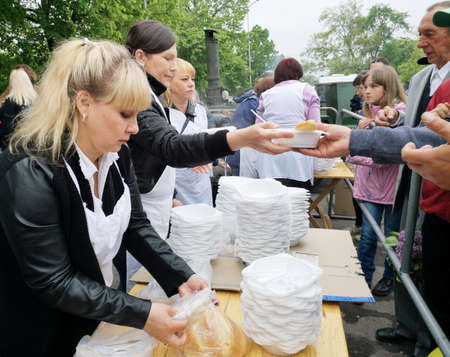 NIKOPOL, UKRAINE - MAY, 2019: distribution of food to the needy, charity event Banco de Imagens - 124659661