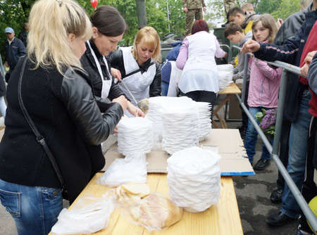 NIKOPOL, UKRAINE - MAY, 2019: distribution of food to the needy, charity event Banco de Imagens - 124659663