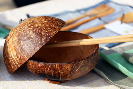 Traditional Chinese dishes - a plate of coconut. Eco-dishes: a bowl of coconut scarlet, Chinese chopsticks.