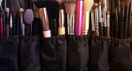 Makeup brushes, different in size and shape. Case makeup artist. Mobile photo