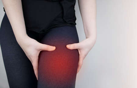 A woman suffers from hip pain. The concept of treating a hip joint for trauma, plantation or osteoarthritis. Stock Photo