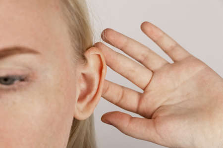 Darwin's tubercle on the ear. The girl at the reception at the plastic surgeon, shows the auricle.