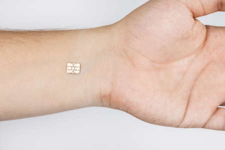 The man shows his hand with a chip implanted. The concept of chipping and implantation of electronic technologies into the human body. Cybernetics and the nanofuture Banco de Imagens