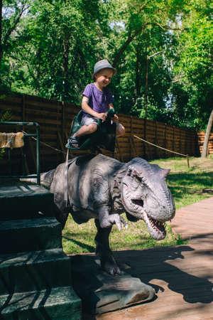 A close-up of a full-length mini Tyrannosaurus Rex. Reconstruction of extinct species. Swing for children. Styling extinct animals. Dinosaurs robots, animatronics and robotics Stock Photo