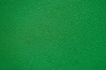 scabrous: wall rough texture  green color background