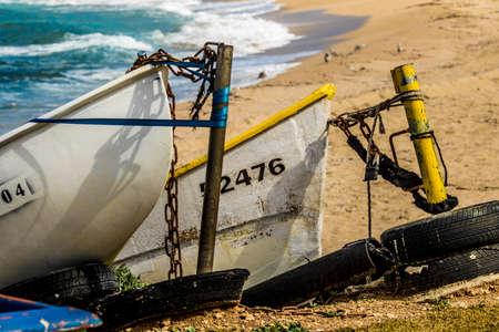 Two boats anchor at the beach at Haifa, Israel