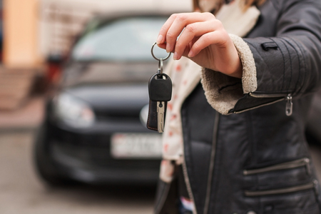 Female hand over the keys of the car photo