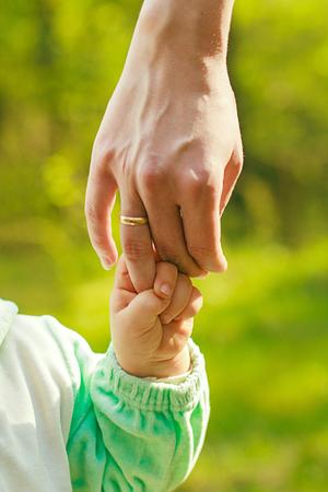 stroll: hand baby holds a finger mom love stroll