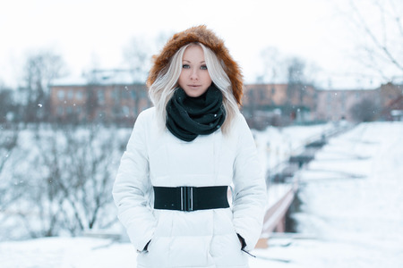 cold woman: Beautiful girl in a winter jacket in the park